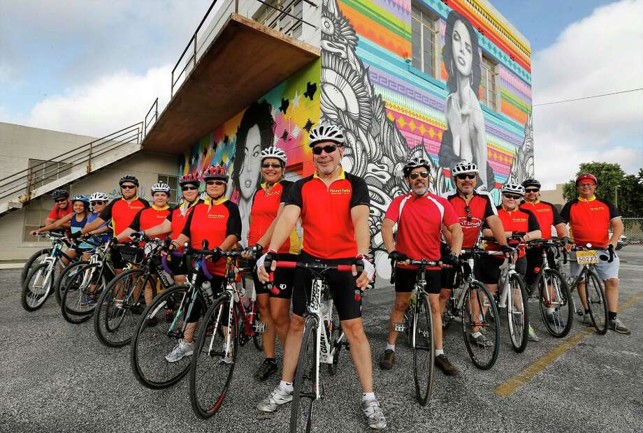 Members of the cycling group, Street Ratz, pose for a group shot in front of a mural near North St. Mary's and Richmond Avenue before embarking on a ride around the city on Saturday, July 11, 2015. The group went on a 16-mile ride while pausing to see murals around downtown and on the Westside. Photo: Kin Man Hui /San Antonio Express-News / ©2015 San Antonio Express-News