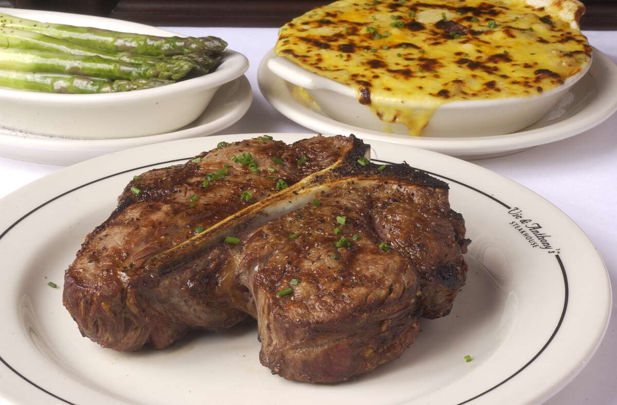 The food, as well as conspicuous consumption, is big at Vic & Anthony's: This porterhouse steak for two, served with steamed asparagus and au gratin potatoes, weighs in at 40 ounces.