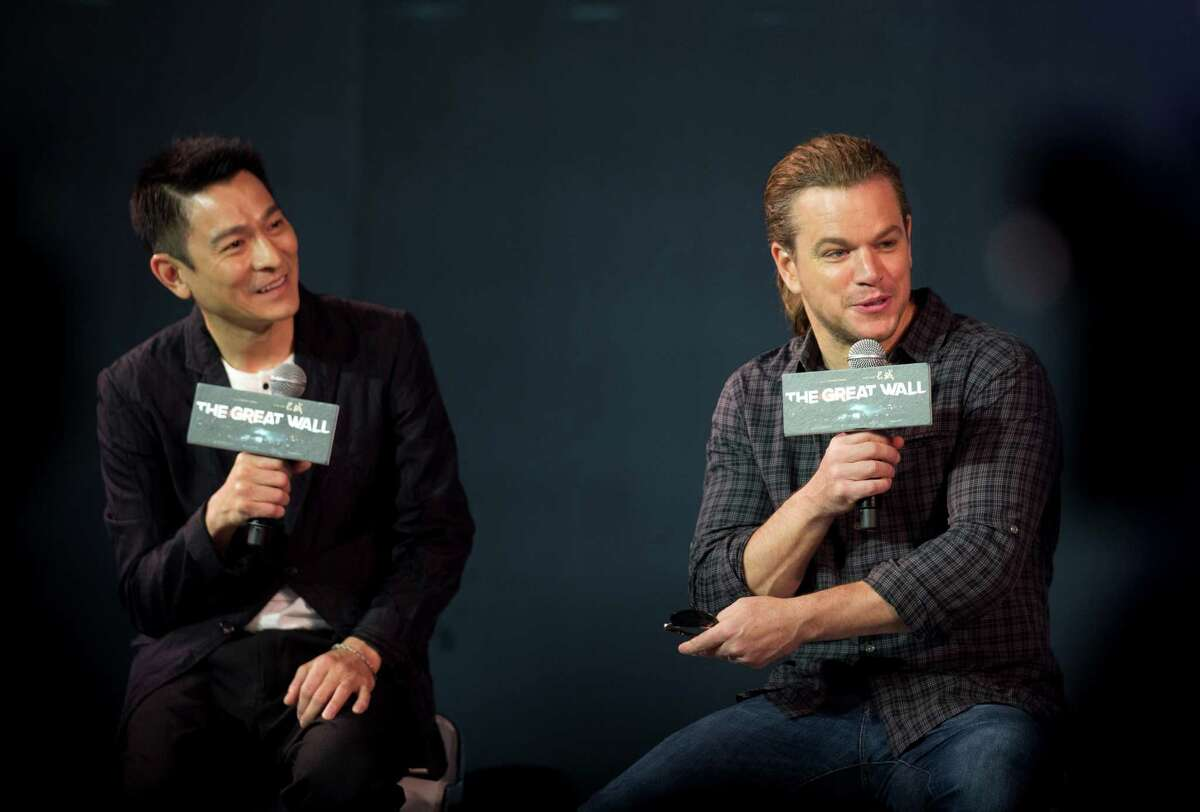 """Actor Matt Damon, right, speaks next to Hong Kong movie star Andy Lau during a press conference of their latest movie """"€œThe Great Wall"""" held at a hotel in Beijing, China, Thursday, July 2, 2015."""