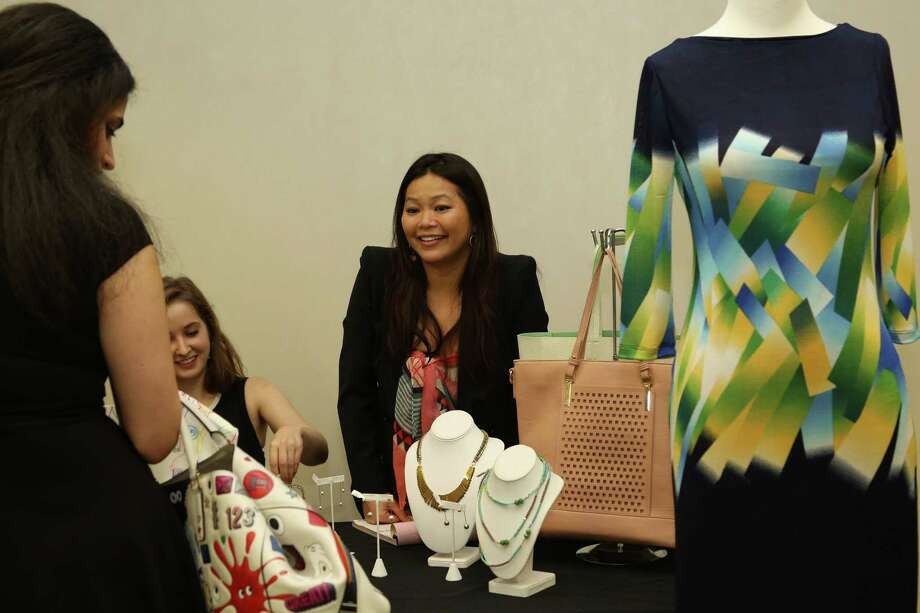 Chloe Dao, center, at Dress for Success' Women of Wardrobe event.