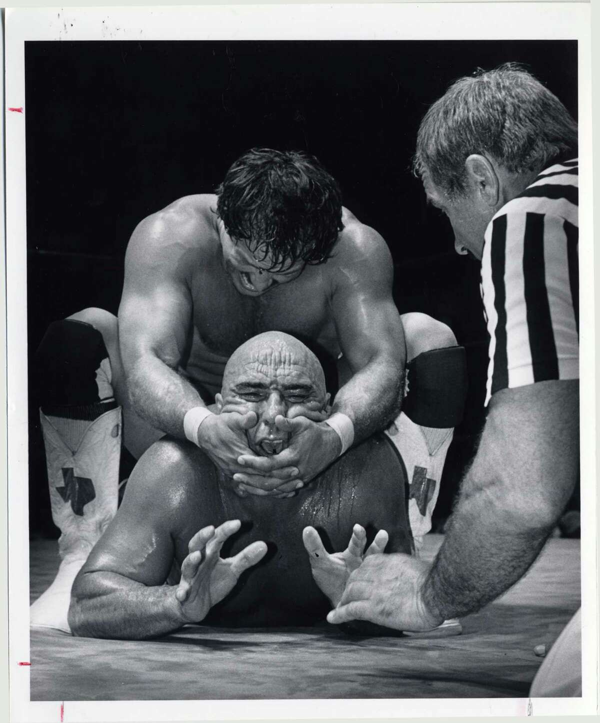 Cowboy Scott Casey puts a head lock on the Mongolian Stomper at Sam Houston Coliseum in 1982. File photo