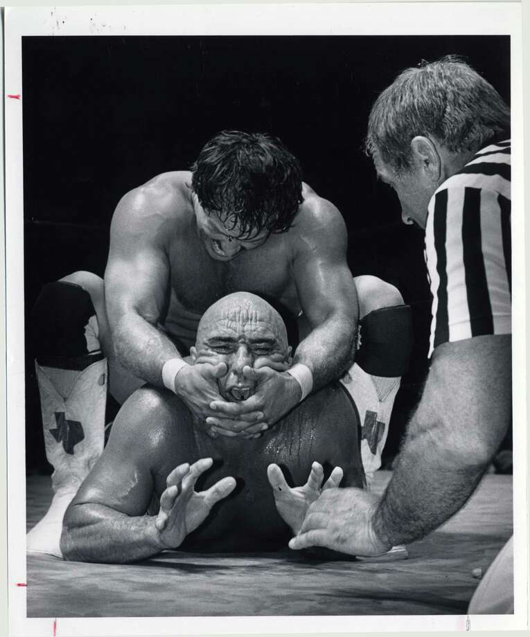 Cowboy Scott Casey puts a head lock on the Mongolian Stomper at Sam Houston Coliseum in 1982. File photo Photo: Betty Tichich, HP Staff / Houston Post files