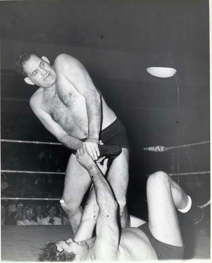 Wrestler, promoter and radio personality Paul Boesch, standing, in the ring in 1958. Later, Boesch helped train youth in the Houston area and sponsored Universal Wrestling Federation shows. / handout