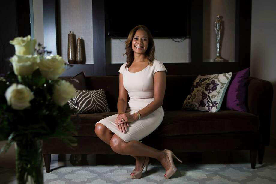 Dr. Camille Cash has designed her office space from scratch to reflect her modern taste, with pops of purple, elegant accessories and classic lines. Photo: Marie D. De Jesus, Staff / © 2015 Houston Chronicle