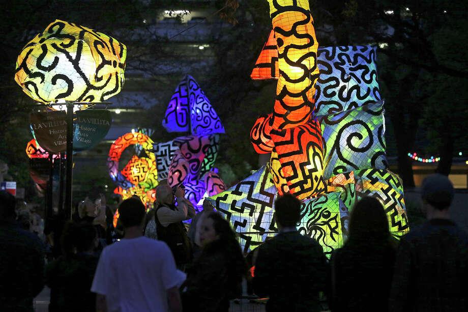 La Villita is lit with artwork from Charles Harriso-Pompa as Luminaria is held in downtown San Antonio on March 9, 2013. Photo: Tom Reel /San Antonio Express-News / San Antonio Express-News