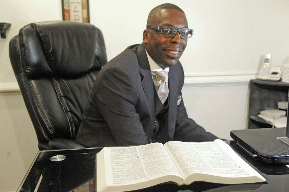 Rev. Charles Daniel who will be installed as minister of Mount Calvary Baptist Church on Sunday, July 19 in his office on Friday July 10, 2015 in Albany, N.Y. (Michael P. Farrell/Times Union) Photo: Michael P. Farrell / 00032564A