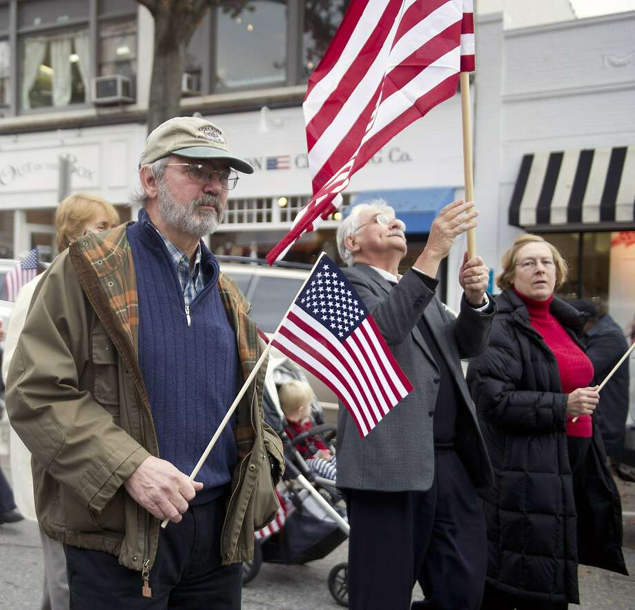 Vietnam Army veteran Kip Burgweger, left, walks in the annual Community Walk and down Greenwich Ave. and Greenwich American Legion ceremony in Greenwich, Conn., on Veteran's Day, Tuesday, November 11, 2014. Photo: Lindsay Perry