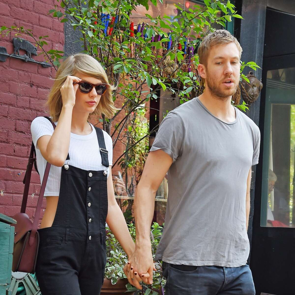 Taylor Swift and Calvin Harris get lunch at the Spotted Pig on May 28, 2015 in New York, New York. (Photo by Josiah Kamau/BuzzFoto via Getty Images)