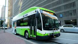 A GreenLink shuttle is seen along Smith Street, Friday, July 17, 2015, in Houston. As Houston continues to develop bigger commercial and office nodes that operate like their own separate downtowns, circulators are making a comeback in a big way. Some, like MetroNational's Memorial City Shuttle and the GreenLink in downtown Houston have operated for years, but keep getting stronger.