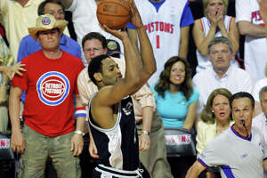 Spurs' Robert Horry gets set to launch the game-winning 3-point shot during overtime of Game 5 of the NBA Finals against the Detroit Pistons at The Palace of Auburn Hills on June 19, 2005.