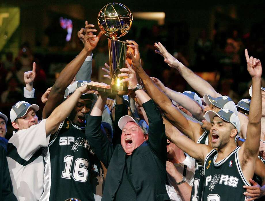 San Antonio Spurs owner Peter Holt (C) holds up the Larry O'Brien Trophy with players Tony Parker (R) and Francisco Elson (L) after defeating the Cleveland Cavaliers to win the NBA Finals basketball series in Cleveland, Ohio, June 14, 2007. REUTERS/Hans Deryk (UNITED STATES) Photo: HANS DERYK / REUTERS / X01986