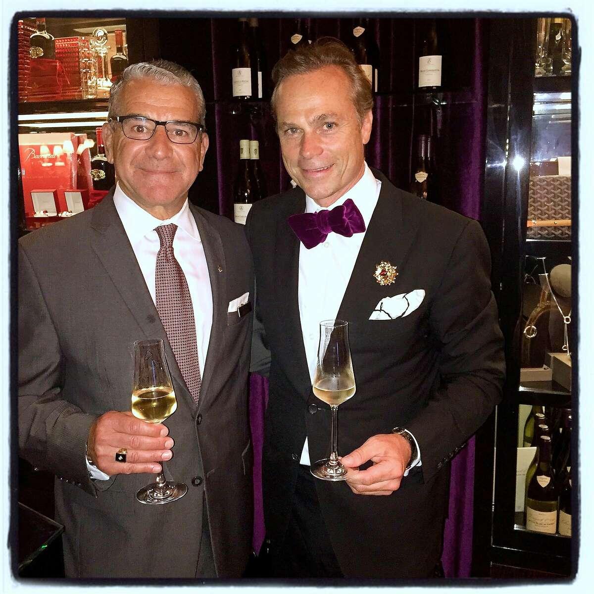 Ritz-Carlton GM Bruce Gorelick (left) celebrates the hotel's new wine lounge with designing vintner Jean-Charles Boisset. July 2015.