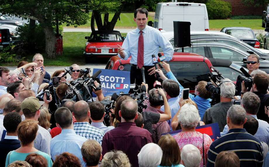 FILE - In this July 16, 2015 file photo, Republican presidential candidate, Wisconsin Gov. Scott Walker, R-Wis., speaks in Amherst, N.H. Unhappy with President Barack Obama's nuclear deal with Iran? The solution is as simple as putting a Republican in the White House, according to GOP candidates who have vowed to rescind the agreement, some on their first day in office. (AP Photo/Jim Cole, File) Photo: Jim Cole, STF / AP