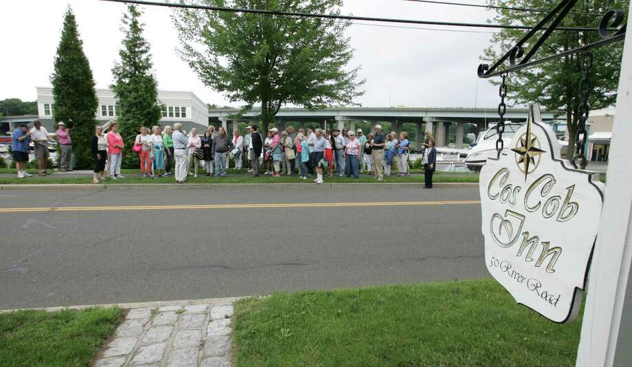 Participants stand across from the Cos Cob Inn during a walking tour of the Cos Cob area in Greenwich, Conn. on Saturday, June 20, 2015. Photo: Matthew Brown / For Hearst Connecticut Media / Connecticut Post Freelance