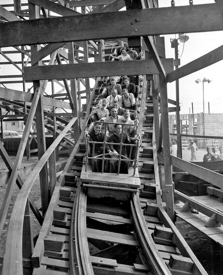 Customers at Playland-at-the-Beach (in 1948 it was called Whitney's at the Beach) enjoy the thrills on the Big Dipper roller coaster, which was shut down in 1955 under a new city building code. Photo: Chronicle Staff Photo / The Chronicle 1948 / ONLINE_YES