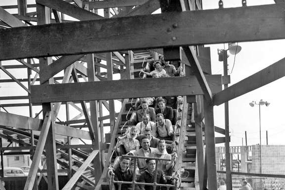 Customers at Playland-at-the-Beach (in 1948 it was called Whitney's at the Beach) enjoy the thrills on the Big Dipper roller coaster, which was shut down in 1955 under a new city building code.