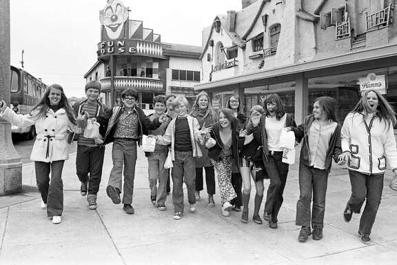 Above: It's the last day for Playland-at-the-Beach, Sept. 25, 1972, just before the auction sale and young people line up to get in on it. Left: Patrons at Playland in 1948 could still enjoy the Flying Scooters fun ride.