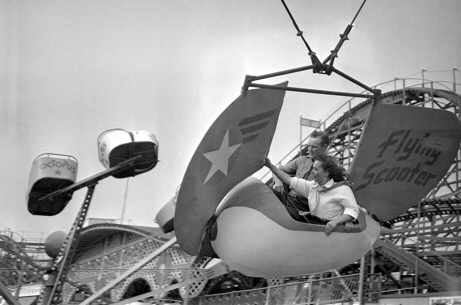 Customers at Playland-at- the-Beach enjoy the Flying Scooters in 1948. Photo: Aaron Rubino / Aaron Rubino / The Chronicle 1948 / ONLINE_YES