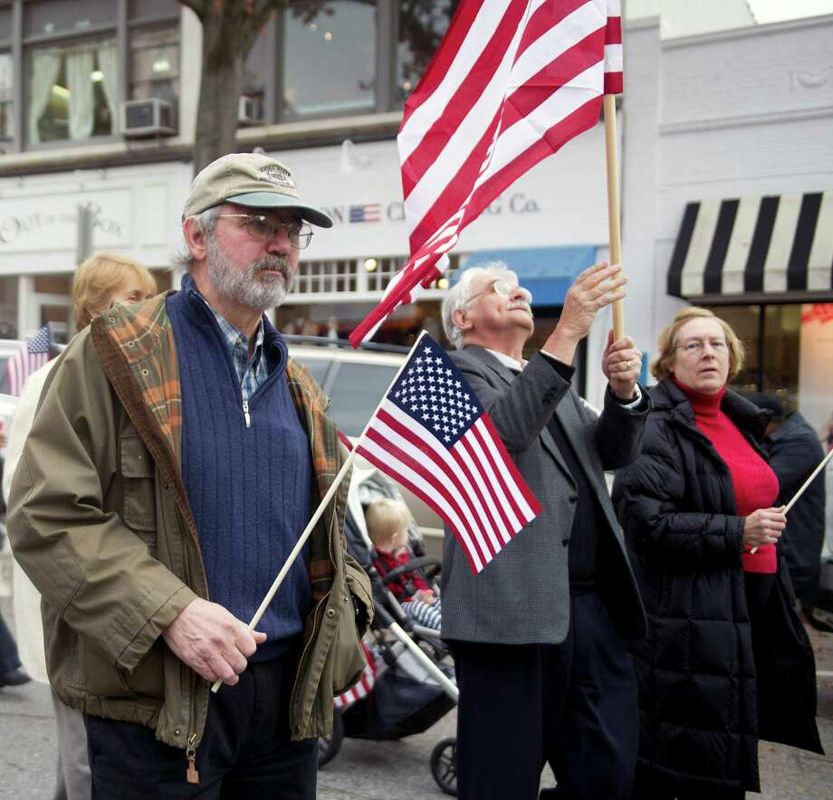 Vietnam Army veteran Kip Burgweger, left, walks in the annual Community Walk down Greenwich Ave. and Greenwich American Legion ceremony on Veteran's Day 2014. This year's Veteran's Day parade will honor Vietnam veterans. Photo: Lindsay Perry / Lindsay Perry / Stamford Advocate