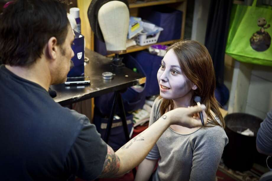 A stylist applies monster makeup on a girl at Creep Show Camp in San Francisco. Photo: David L. Wilson David@