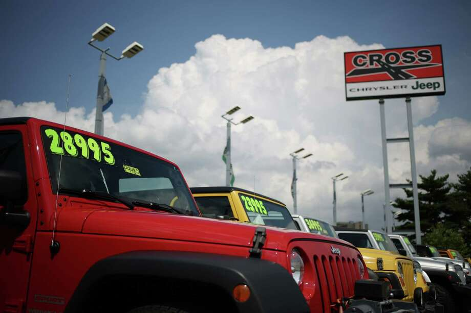 Chrysler Group LLC Jeep Wrangler vehicles are displayed for sale at the Cross Chrysler Jeep dealership in Louisville, Kentucky. Offers and incentives typically change at the beginning of each month, so it is best to check what is available before going car shopping. Photo: Luke Sharrett /Bloomberg News / © 2015 Bloomberg Finance LP