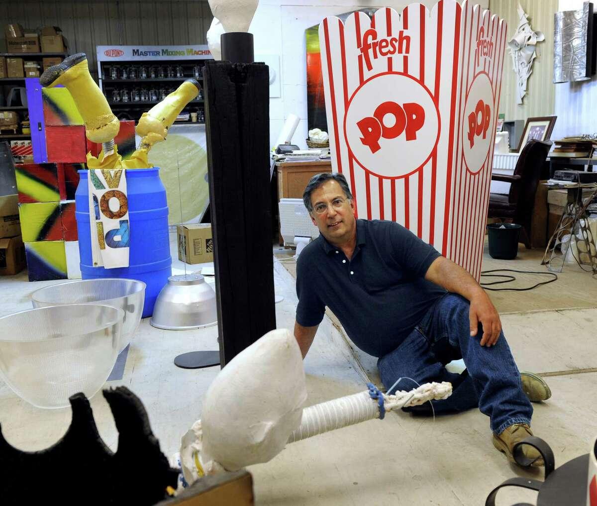 Jim Felice sits amid some of his artwork in his studio space in Danbury.