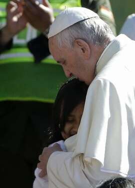 Pope Francis hugs a child in Bolivia