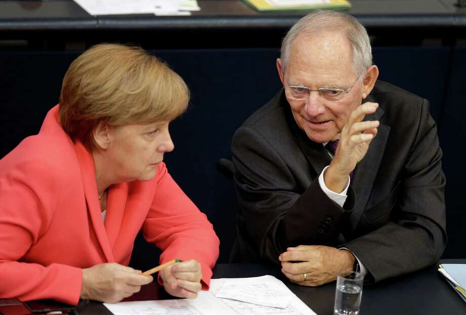 In a meeting with German Finance Minister Wolfgang Schaeuble on Friday, Chancellor Angela Merkel urged lawmakers to vote in favor of a third bailout package for Greece, arguing the cash-strapped country faces chaos without a deal. Photo: Michael Sohn, STF / AP
