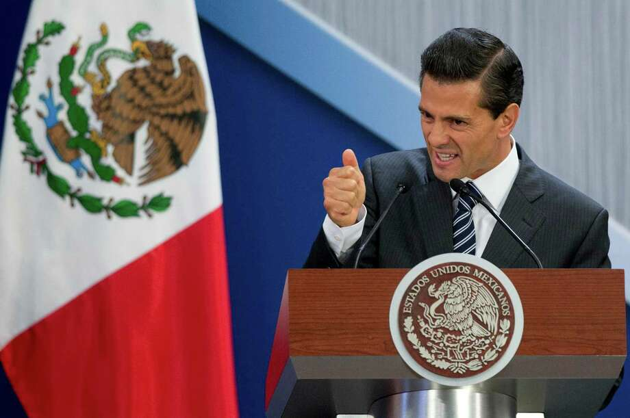 """Mexico President Enrique Pena Nieto defends his actions in the wake of the escape of Joaquin """"El Chapo"""" Guzman. """"We are not going to solve this issue by getting angry, and filling ourselves with rage,"""" he said. """"The only way to answer this insult without doubt is by recapturing this criminal,"""" Photo: Eduardo Verdugo, STF / AP"""
