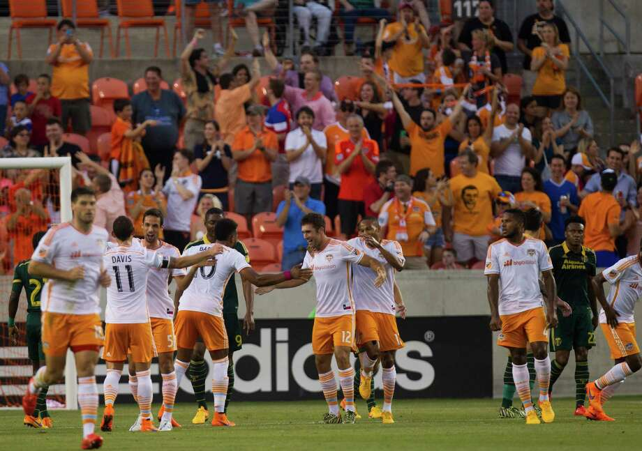 Forward Will Bruin, center, will play with several new faces Saturday night with the Dynamo forced to shuffle the roster and lineup as several players are competing with their national teams. Photo: Marie D. De Jesus, Staff / © 2015 Houston Chronicle