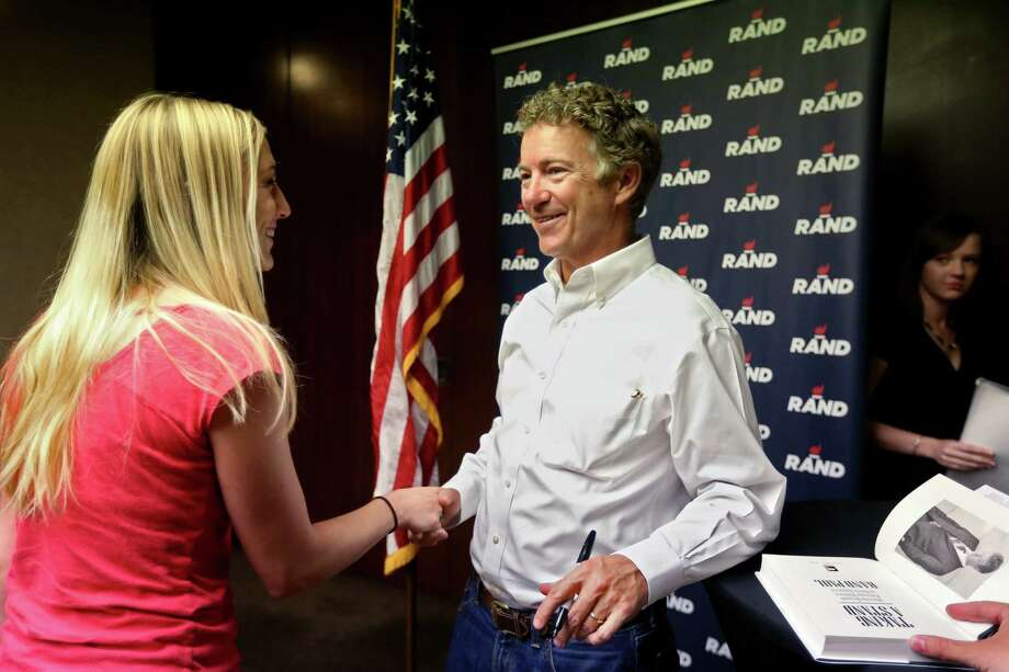 Republican presidential candidate Sen. Rand Paul greets a supporter at the Hyatt Regency in Houston. Photo: Gary Coronado /Houston Chronicle / © 2015 Houston Chronicle