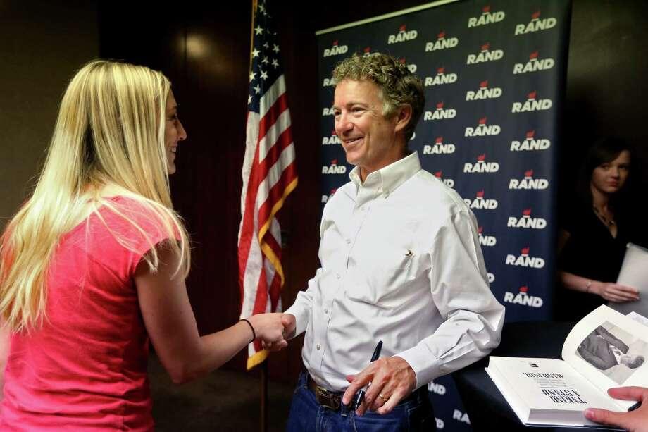 Republican presidential candidate Sen. Rand Paul greets a supporter at the Hyatt Regency in Houston. Photo: Gary Coronado /Houston Chronicle / © 2015 Houston Chronicle