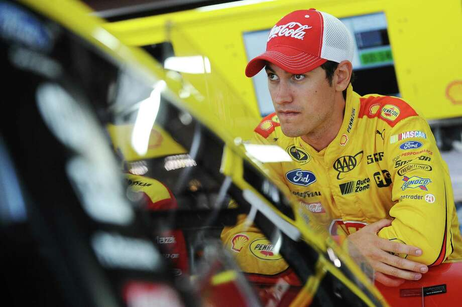 LOUDON, NH - JULY 17:  Joey Logano, driver of the #22 Shell Pennzoil Ford, looks on in the garage area during practice for the NASCAR Sprint Cup Series 5-Hour Energy 301 at New Hampshire Motor Speedway on July 17, 2015 in Loudon, New Hampshire.  (Photo by Rainier Ehrhardt/Getty Images) ORG XMIT: 532279227 Photo: Rainier Ehrhardt / 2015 Getty Images