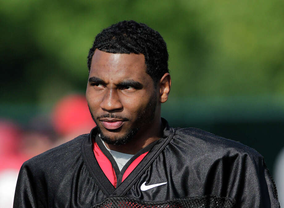In this Aug. 9, 2014, file photo, Ohio State quarterback Braxton Miller watches teammates warm up during an NCAA college football practice in Columbus, Ohio. Miller, among the top contenders for the Heisman Trophy, reportedly reinjured his throwing shoulder during practice. The report about the two-time Big Ten offensive player of the year comes with just more than two weeks before the No. 5 Buckeyes open the season. (AP Photo/Jay LaPrete, File) Photo: Jay LaPrete, FRE / FR52593 AP