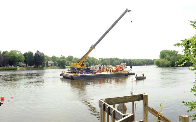 Dredging operations on the Hudson River as part of General Electric's PBC abatement from the river bed inn the upper Huds on Riveron Friday, July 17, 2015, in Mechanicville, N.Y. (Michael P. Farrell/Times Union) Photo: Michael P. Farrell / 00032668A