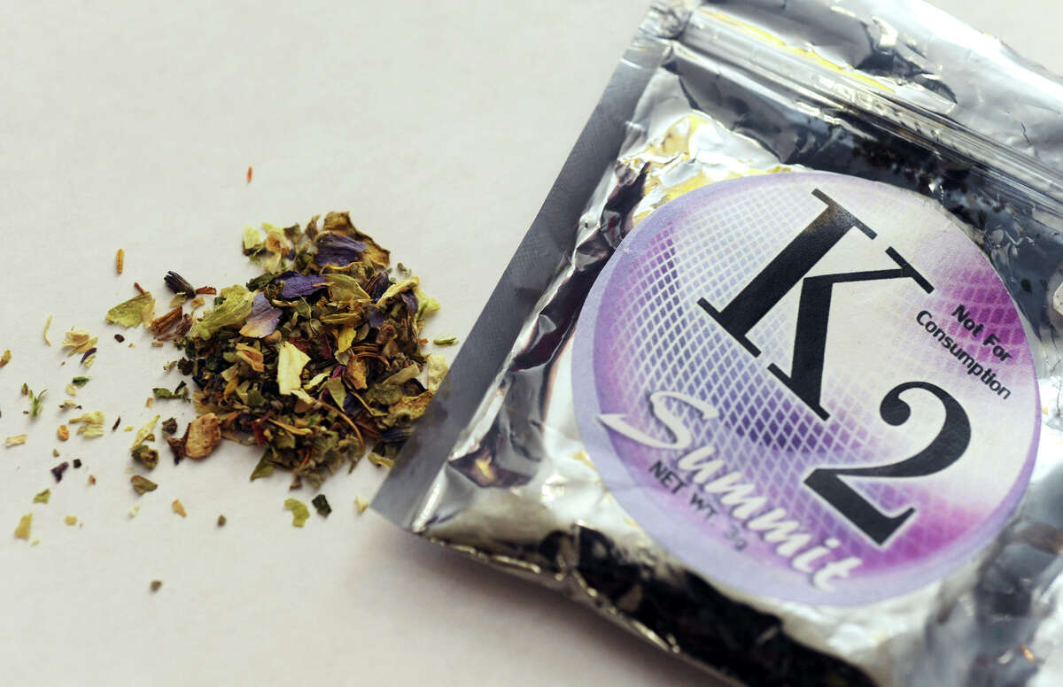 FILE - This Feb. 15, 2010, file photo, shows a package of K2 which contains herbs and spices sprayed with a synthetic compound chemically similar to THC, the psychoactive ingredient in marijuana. According to the American Association of Poison Control Centers, more than 1,500 people in several states became ill in April 2015 from smoking synthetic marijuana sold under several brand names, including K2, Spice, Crazy Clown and Scooby Snax. (AP Photo/Kelley McCall, File)
