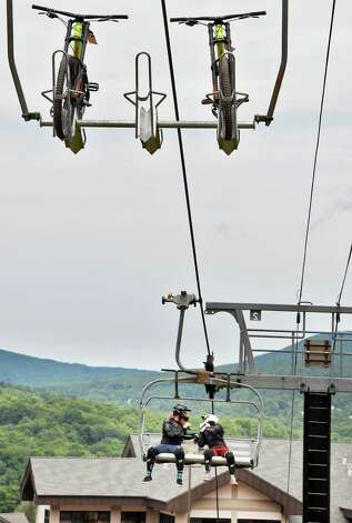 Bicycles and riders take the ski lift up Windham Mountain Resort's new mountain bike park Friday July 17, 2015 in Windham, NY.  (John Carl D'Annibale / Times Union) Photo: John Carl D'Annibale / 00032665A