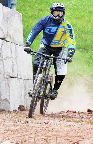 Mark Brown of New Haven, Conn. rides the trails at Windham Mountain Resort's new mountain bike park Friday July 17, 2015 in Windham, NY.  (John Carl D'Annibale / Times Union) Photo: John Carl D'Annibale / 00032665A