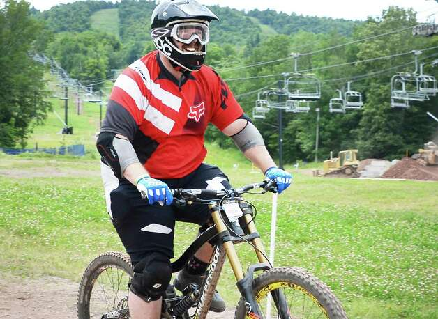 Jim McMurchy of Derry, NH rides the trails at Windham Mountain Resort's new mountain bike park Friday July 17, 2015 in Windham, NY.  (John Carl D'Annibale / Times Union) Photo: John Carl D'Annibale / 00032665A