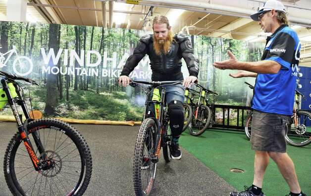 Mark Brennan of Brooklyn, left, gets fitted for equipment by bike park mechanic Pat Garrison at Windham Mountain Resort's new mountain bike park Friday July 17, 2015 in Windham, NY.  (John Carl D'Annibale / Times Union) Photo: John Carl D'Annibale / 00032665A