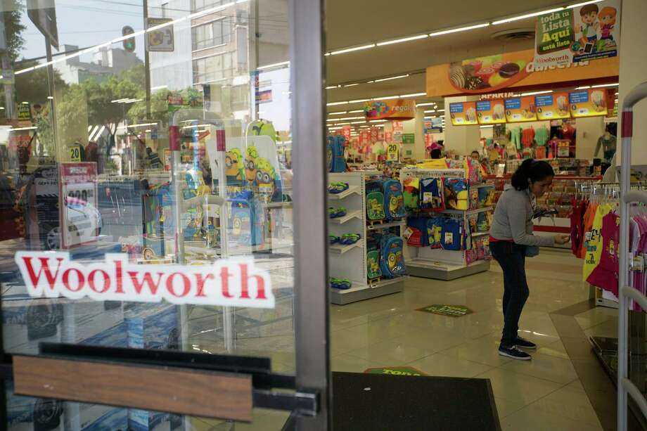 A shopper looks at children's clothing at a Woolworth store in Mexico City this week. Blockbuster, Woolworth and Sears are getting new life south of the border. Photo: Susana Gonzalez / © 2015 Bloomberg Finance LP