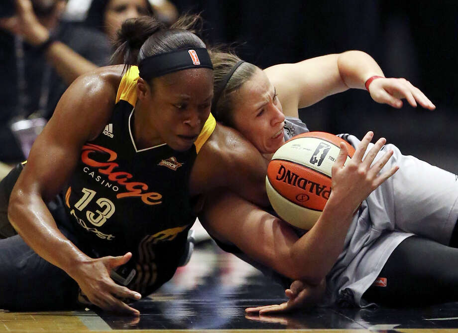 Tulsa Shock's Karima Christmas and San Antonio Stars' Samantha Logic grab for a loose ball during first half action Friday July 17, 2015 at the Freeman Coliseum. Photo: Edward A. Ornelas, Staff / San Antonio Express-News / © 2015 San Antonio Express-News