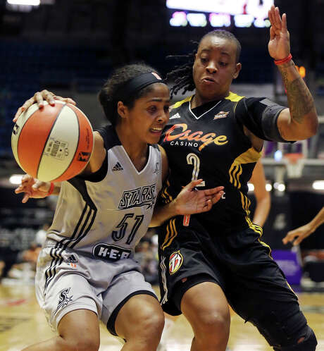 San Antonio Stars' Sydney Colson looks for room around Tulsa Shock's Riquna Williams during first half action Friday July 17, 2015 at the Freeman Coliseum. Photo: Edward A. Ornelas, Staff / San Antonio Express-News / © 2015 San Antonio Express-News