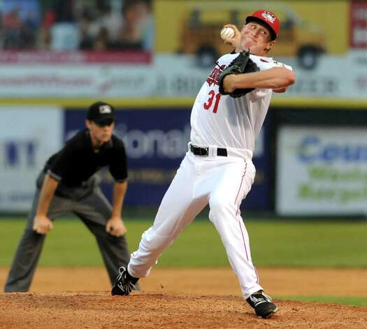 ValleyCats Trent Thornton, right, winds up the pitch during their baseball game against the Lake Monsters on Friday, July 17, 2015, at Joe Bruno Stadium in Troy, N.Y. (Cindy Schultz / Times Union) Photo: Cindy Schultz / 00032629A