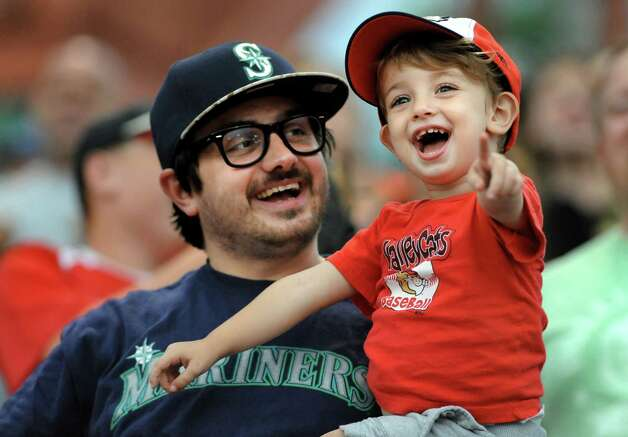 ValleyCats fans Jason Tagliatela of Cohoes, left, and his son Jackson Tagliatela, 2, have some fun during their baseball game against the Lake Monsters on Friday, July 17, 2015, at Joe Bruno Stadium in Troy, N.Y. (Cindy Schultz / Times Union) Photo: Cindy Schultz / 00032629A