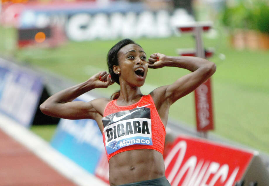Ethiopia's Genzebe Dibaba rejoices as she realizes she has just broken the world record in winning the 1,500 meters at a Diamond League meet in Monaco. Photo: Claude Paris, STR / AP