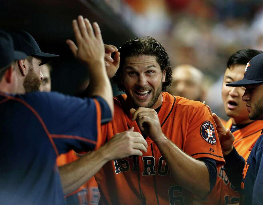 Jake Marisnick celebrates in the Astros' dugout after scoring on Jose Altuve's RBI double in the third inning Friday night at Minute Maid Park. Photo: Karen Warren, Staff / © 2015 Houston Chronicle