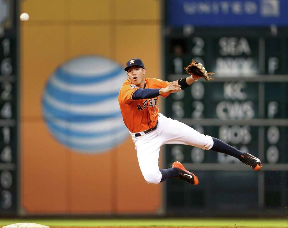 Astros shortstop Carlos Correa ends the Rangers' threat in the ninth inning, throwing out Prince Fielder at first with another runner on base to secure the 3-2 victory Friday at Minute Maid Park. Photo: Karen Warren, Staff / © 2015 Houston Chronicle