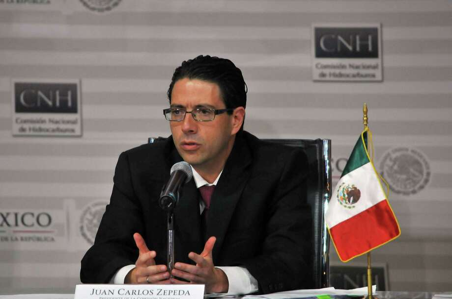 Mexico's National Comission of Hydrocarbons president Juan Carlos Zepeda speaks during the Round One First Tender --presentation and opening of proposals-- of the National Hydrocarbons Commission in Mexico City, on July 15, 2015. Mexico's historic first oil auction fell short of expectations on Wednesday, with only two of 14 blocks in the Gulf of Mexico awarded to a Mexican-led consortium.   AFP PHOTO/MARIA  CALLSMARIA CALLS/AFP/Getty Images Photo: MARIA CALLS, Stringer / Agencia2.8