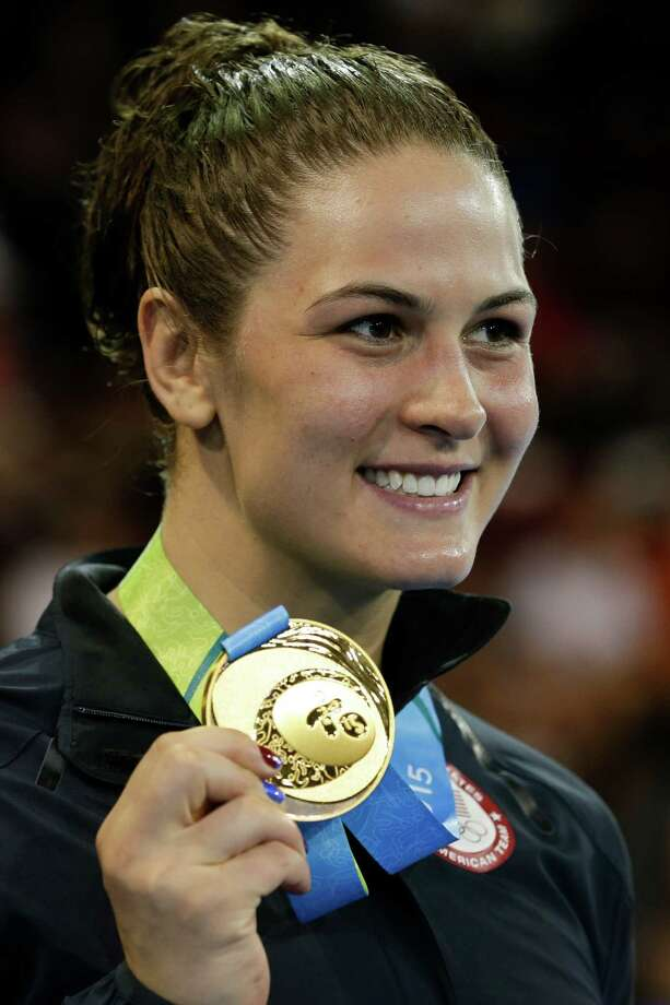 The United States' Adeline Gray poses wearing her gold medal after winning it in 75 kg freestyle women's wrestling competition in the Pan Am Games in Mississauga, Ontario, Friday, July 17, 2015. Photo: Gregory Bull, Associated Press / AP
